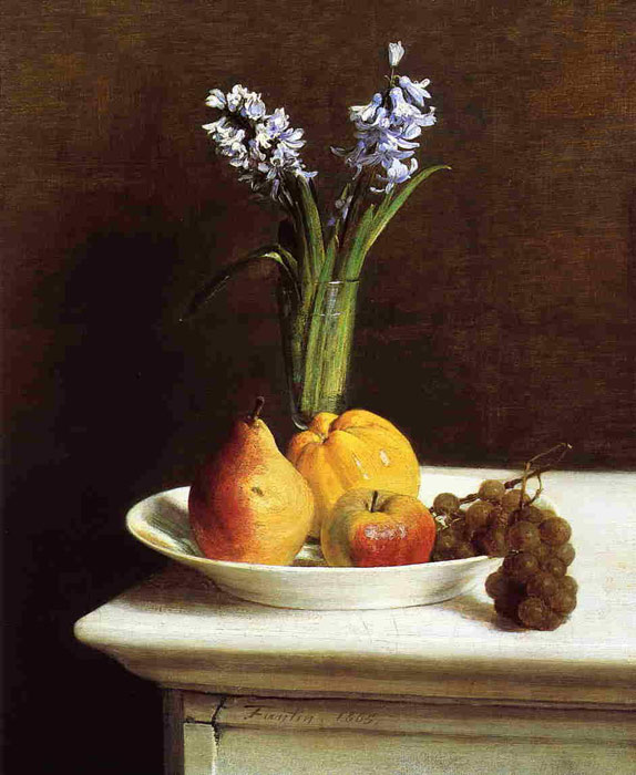flower in glass and fruit in the plate