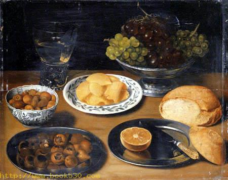 Grapes in a pewter bowl with a bread roll