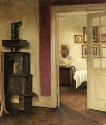 An Interior with a Stove and a View into a Dining Room