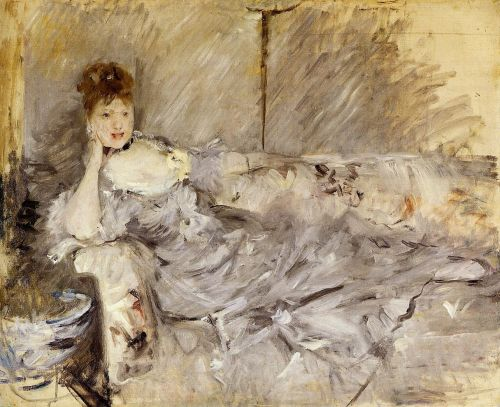Young Woman in Grey Reclining