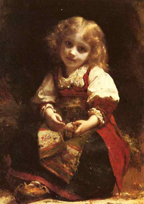 A Little Girl Holding A Bird