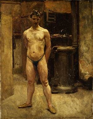 A Male Model Standing before a Stove